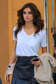 I love Taylor Hill's simple look: white t-shirt + leather skirt + little beige Chanel bag