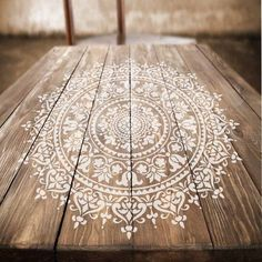 The Prosperity Mandala Stencil was painted on a wooden piece of furniture. This table was easily upcycled to look new using this yoga pattern from Cutting Edge Stencils. http://www.cuttingedgestencils.com/prosperity-mandala-stencil-yoga-mandala-stencils-designs.html