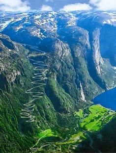 Norway. The road at one point doubles back into a tunnel in the mountain and exits at the bottom.