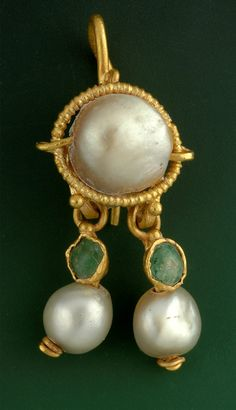 This stunningly intact 2,000-year-old gold, pearl, and emerald earring was discovered under a parking lot just outside Jerusalem's Old City.    The earring was found in the remains of a fourth- or fifth-century A.D. Byzantine-era structure, which the parking lot had been built over. Photographic by Clara Amit, courtesy of the Israel Antiquities  Authority
