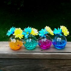 Ever wonder what to do with your kids leftover Orbeez? Use them to make flower arrangements more colorful!