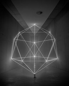 """James Nizamproduces subtle, geometric light installations with programmable lighting elements and mirrors, the resulting pieces looking like snapshots of a strictly choreographed laser light show. In his 2011 series """"Thought Forms,"""" Nizam gained entrance to a domestic structure to ins"""