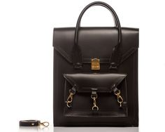 Black Pelham tote bag can be worn across the body as a cross body bag with a detachable shoulders straps. The structured smooth sturdy cow leather comes with all gold-tone hardware the main front clutch lock its a Swiss-made lock, and with three trigger hooks and D ring hardware. The handle of the bag it's a rolled skinny handle with chunky stitches on both sides of the handle and leather pattern trimmings.  #bag #handbag #tote #black