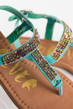 These jeweled sandals are perfect for a sunny spring or summer day! The t-strap is covered in small, multi-colored jewels, giving you a pretty touch of color.