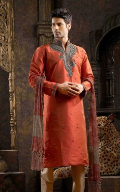 Get red designer sherwani from the stylish collection of Red Sherwani and Designer Sherwani for men. Men love to wear this sherwani Kurta on special occasions. This is made from shinny silk fabric and outstanding embroidery work on the neck. Order us now to grab this amazing piece of sherwani. Instead Of $300 YOu Can Get This Sherwani In $260.