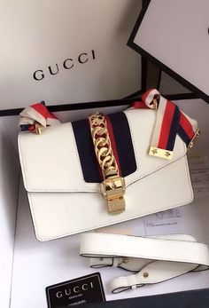 Gucci Sylvie Leather Shoulder Bag White. Find details at http://www.luxtime.su/gucci-sylvie-leather-shoulder-bag-gu421882-white
