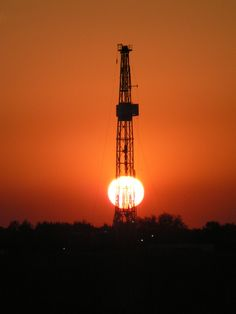 drilling rig on our land west of virden,manitoba at sunset