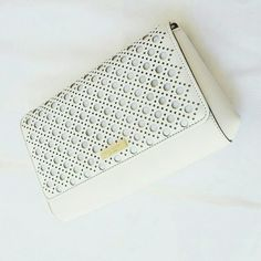 "Kate Spade white laser cut detail safiano leather Brand new with tag. Perfect for spring and summer. Can be a clutch or crossbody. Approximately 11x6.5x2"". Adorable white laser cut details on safiano leather.  Asking for reasonable offers. I put a high price so I can drop it for you. kate spade Bags Clutches & Wristlets"