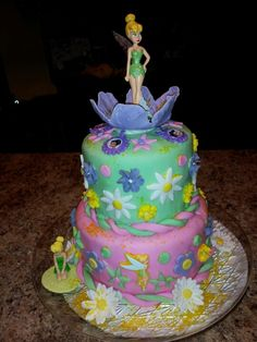 Tink is 5.  Great niece asked for tinkerbell cake for 5th birthday.  This was first attempt at a tier cake. Flowers and cake are home made fondant