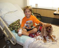 Pet Therapy Dog Toby visits Xavier on the children's patient floor at Renown Regional Medical Center.