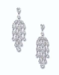 A PAIR OF DIAMOND EAR PENDANTS   Each pear-shaped diamond surmount suspending an articulated cascade of marquise-cut diamonds, terminating with graduated pear-shaped diamonds, mounted in platinum