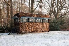 Perfectly Camouflaged Log Cabin by Hans Linberg Looks Like a Pile of Firewood