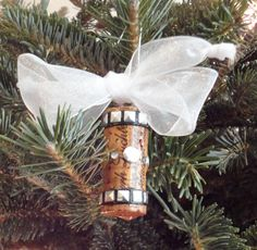 Great gift idea for ornament or attached to a wine bottle. Corks are dipped in polyurethane for the shine and decorated with beads or bits of old jewelry!