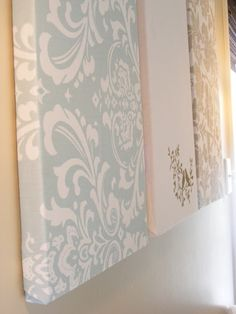 The fabric/paper/wallpaper around a canvas idea is one I've pinned a lot.  But this blogger added an extra level of thriftiness by not buying canvas at all.  It's cut Styrofoam!