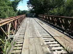 Located in downtown Shelbyville, Kentucky, this abandoned bridge is hidden amidst trees and terrain. Hiding with it is a strange secre. Picture Places, Abandoned Places, World War Two, Vintage Ads, Kentucky, The Good Place, Places To Go, Sidewalk, Explore