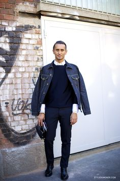 Simone Marchetti by STYLEDUMONDE. Perfect denim jacket , but still don't get this street style affectation of not putting your arms in yr sleeves.