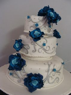 Blue and Silver wedding cake - Blue roses and Silver twirls.  Love this cake, would just like it with gold instead of silver