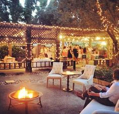 Guests can dance under the arbors or relax on some antique lounge furniture around a fire pit.