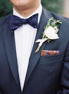 blue suit | polka-dot bow tie | Photography: Brett Heidebrecht - www.brettheidebrecht.com  Read More: http://www.stylemepretty.com/2014/08/14/elegant-midwest-wedding-at-the-oklahoma-history-center/