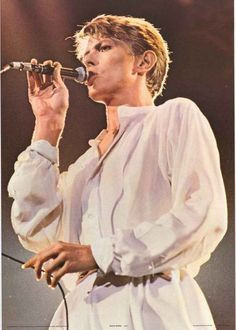 A fantastic portrait poster of David Bowie performing live in 1981! Ashes to…