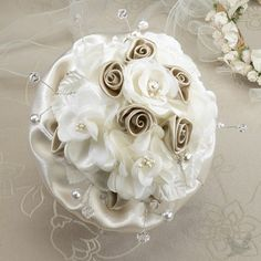 This elegant taupe rose wedding bouquet has a clear acrylic handle, taupe satin ruffle and a series of dark and light taupe satin flowers. The light flowers are decorated with pearl/rhinestone ornaments. Rose Bridal Bouquet, Wedding Bouquets, Wedding Flowers, Hand Bouquet, Wedding Colors, Wedding Dresses, Satin Roses, Satin Flowers, Fabric Flowers