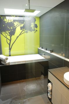 Custom-printed glass, in which a graphic image is adhered to the glass' backside, is backpainted glass' spiffier cousin. Because durability is one of the main green features of glass, seek a graphic image that won't easily become outdated or tired.