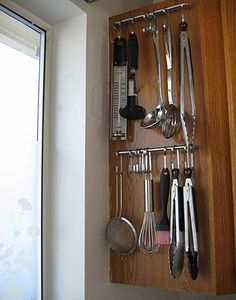 not martha — to make: my small kitchen storage    Ikea Grundtal hooks hung on cabinet handles.