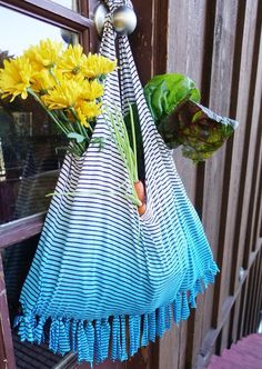 A written and video tutorial on how to upcycle an old, unwanted T-shirt into a cute, no-sew market tote.