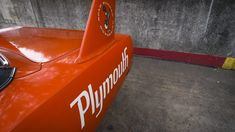 At the height of the American auto industry's muscle car war, there was one that literally stood above all others — the Plymouth Superbird. Plymouth Superbird, Dodge Daytona, Hemi Engine, American Auto, For Sale Sign, Automobile Industry, Bucket Seats, Red Paint, Window Stickers