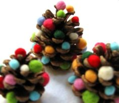Glue colorful pom poms to pine cones for  some cute miniature Christmas trees.