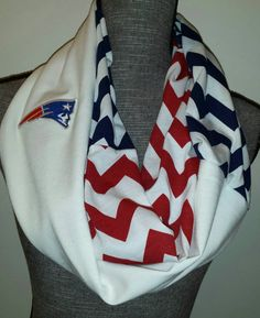 "Patriots Football Scarf with embroidered logo. Hoop length is about 38"" inches long by about 8"" inches wide. Wraps around twice comfortably. Soft stretch cotton blend- Light weight / indoor or outdoor"