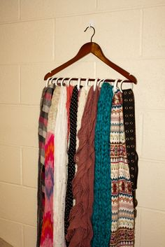 cheap scarf storage, use shower curtain rings on a hanger.