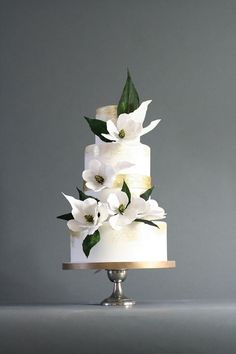 white wedding cake with oversized magnolias