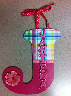 """9"""" Plaid Pink Glitz Girly name letter. Personalized Homemade Nursery decor Wall letters kids door signs birth info plaques crib mobiles canvas art family name door hangers by Billie Landers Bamland Designs Charleston WV PayPal accepted. Mailing available. Come LIKE my page on Facebook http://m.facebook.com/BamlandDesignsCustomNurseryWallLettersMore"""