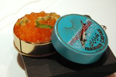 Caviar sférico de melon  Melon caviar -- The savory caviar is turned into a sweet and juice imitation with a melon and passion fruit flavor. To fool the brain even more it is packaged into an El Bulli copy of Iranian caviar tin. #MolecularGastronomy