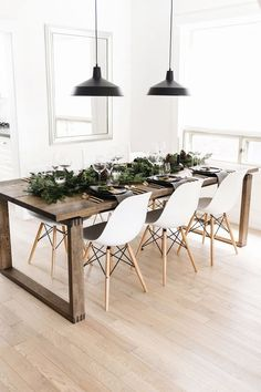 Rustic farm house table, white dining room chairs, black modern pendant lights dining room inspiration