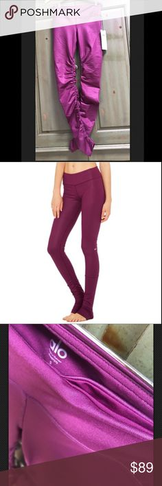 "NWT Alo Yoga Idol Leggings small Brand new with tags!  Gorgeous Juneberry color (a jeweled tone wine or cranberry) ""Idol"" leggings by Alo Yoga. Perfect for barre, yoga, dance, or pilates. Scrunch at ankles or pull over heels.  Built in pocket, elongating and flattering cut, wide waist band that conceals and flattens midsection.  Absolutely love these but now that I'm pregnant i won't be able to wear them for awhile.  Less on E bay! ALO Yoga Pants Leggings"