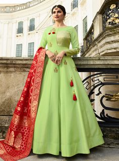 Light green art silk gown with pure banarasi silk dupatta - Proper Traditional Combination Is Here With This Designer Floor Length Readymade Gown In Light Green Colored Top Paired With Contrasting Red Colored Dupatta. Indian Designer Outfits, Designer Gowns, Indian Outfits, Indian Clothes, Indian Designers, Designer Anarkali, Silk Anarkali Suits, Anarkali Dress, Long Anarkali