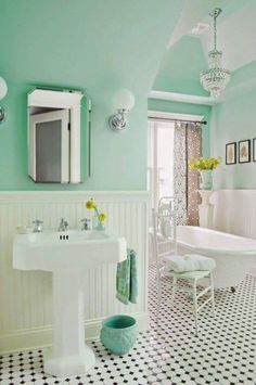 Mint green cottage bathroom - love the claw foot tub, and the pedestal sink!