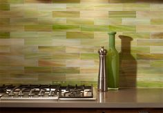 I really love this tiled back splash.  I am loving the green, creams, brown tones and whites combined.  This will be on my list for our kitchen remodel that is somewhere in my dreamy future!