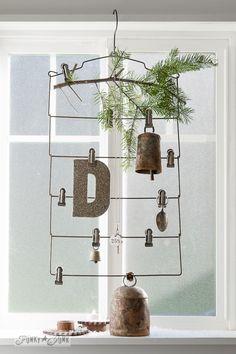 Bells on a vintage hanger window display on FunkyJunkInteriors.net #12days72ideas