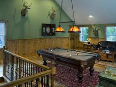 Royal Oak Game Room Addition by MainStreet Design Build. Features include vaulted ceilings, a bar area, large amounts of natural lighting and an open floor plan for a pool table, surround sound, and the owner's many trophy heads.  #homedesign #remodel