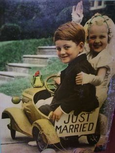 A young 'just married' couple in a peddle car