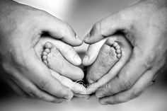 Newborn feet with mom and dad's hands, for someday down the road:)