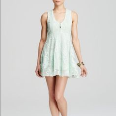 Free People Dress- 0 & 2 Free People embroidered mesh dress - NWT - sizes 0 and 2.  Gorgeous sea green color. Front hook closures and hidden side zipper. Because of the stretch, the size 0 could fit 0-2 and size 2 could fit sizes 2-4.  Shoulder to hem measures approximately 32 inches. This dress is so comfortable, not to mention beautiful! Sold out! Free People Dresses Mini