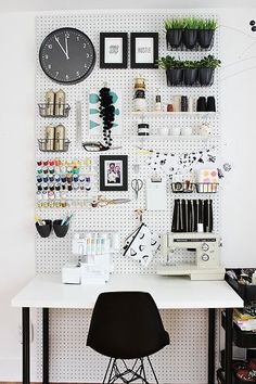 Awesome pegboard work space. Make use of the walls when you're restricted on floor space.