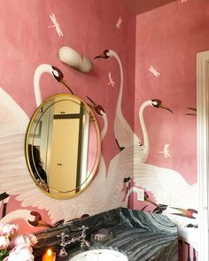 Eclectic bathroom in Pink with painted den mural and black marble vanity