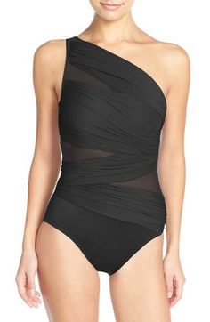 a92d85575222d Give your swimsuit collection a sophisticated twist with this one-shoulder  black illusion bathing suit