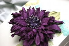 Leather Flower Brooch/Scrunchie Purple art.31V4R74req43452. $135.00, via Etsy.