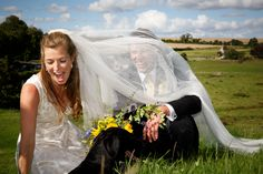 bride and groom in a field on a windy wedding day